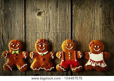 Christmas homemade gingerbread couples on wooden table
