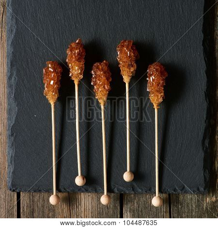 Brown sugar sticks over slate