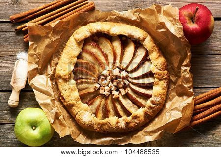 Apple galette over rustic background