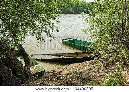 Fisherman Boat Is Tied To The Tree.