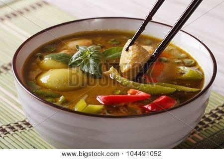 Thai Green Curry With Chicken In A Bowl Macro. Horizontal