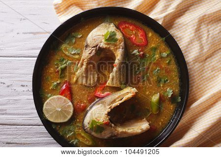 Delicious Spicy Fish Curry With Cilantro Close Up. Horizontal Top View
