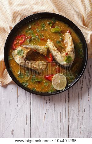 Spicy Fish Curry With Cilantro On The Table. Vertical Top View