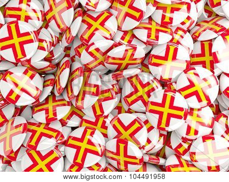 Background With Round Pins With Flag Of Guernsey