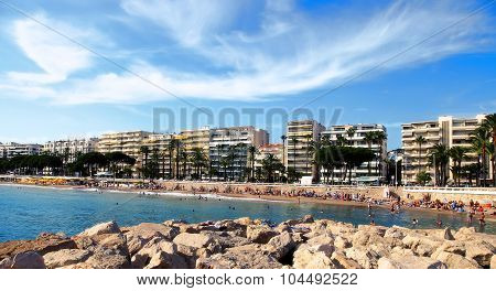 Cannes, France -  July 5, 2014: The Beach In Cannes. Cannes Located In The French Riviera. The City