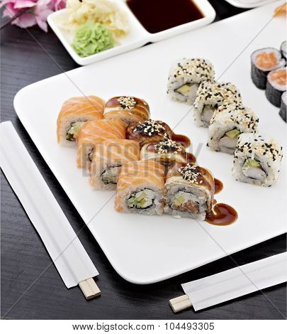 Sushi Set With Chopsticks And Soy Sauce Over Dark Wooden Background
