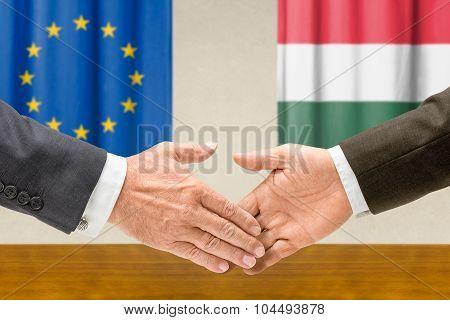 Representatives Of The Eu And Hungary Shake Hands