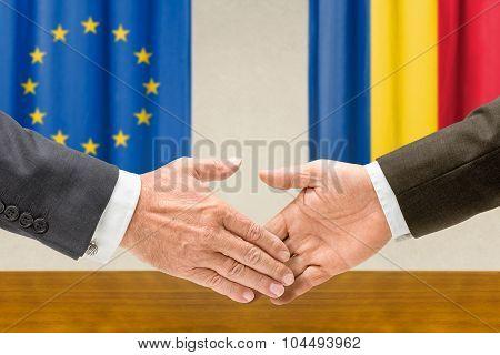 Representatives Of The Eu And Romania Shake Hands