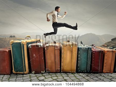 Employee running on a staircase made of suitcases