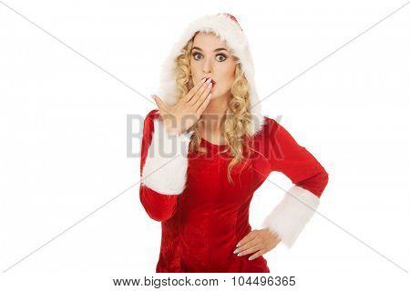 Shocked young beautiful santa woman.