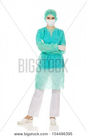 Female surgeon doctor in protective mask.