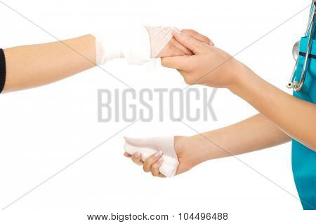 Female doctor bandaging woman hand.