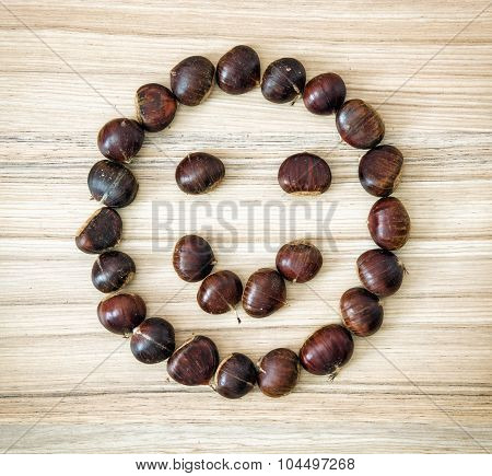 Chestnut Smiley On The Wooden Plate