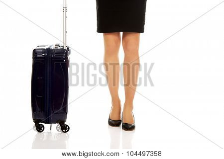 Businesswoman legs with a suitcase.