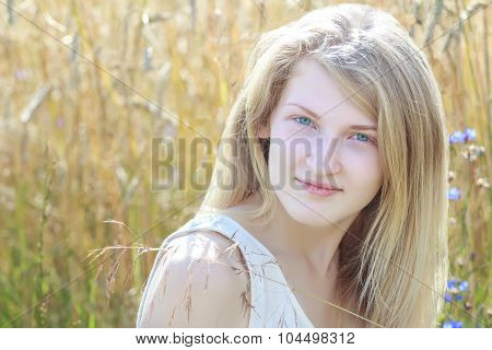 Day Outdoor Headshot Portrait Of Blonde Girl At Rye Ears Field Background