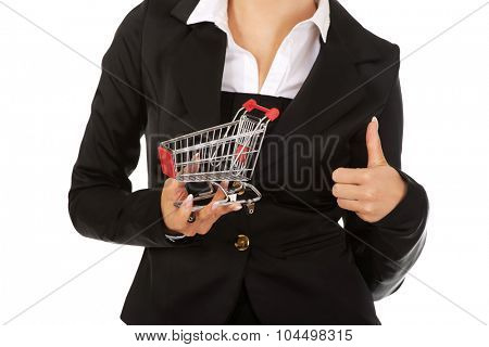 Young businesswoman with shopping trolley.