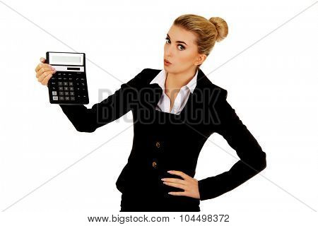 Shocked businesswoman looking at calculator.
