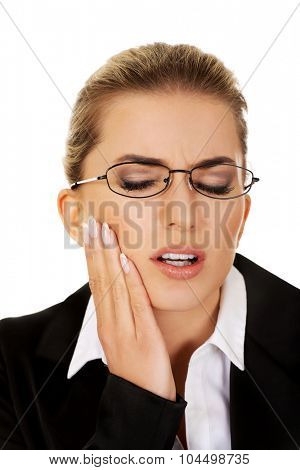 Young woman has a toothache.