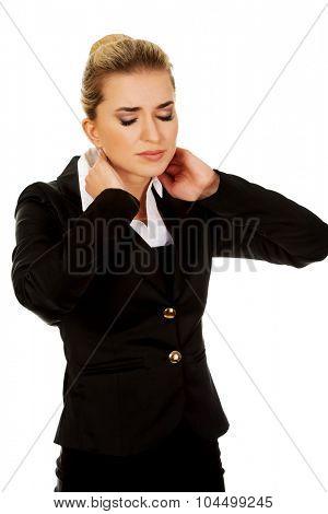 Businesswoman having huge neck ache.