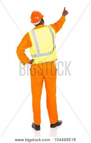 rear view of african contractor pointing at empty space on white background
