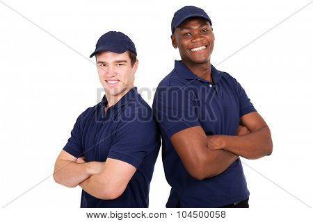 portrait of happy young co-workers with arms crossed