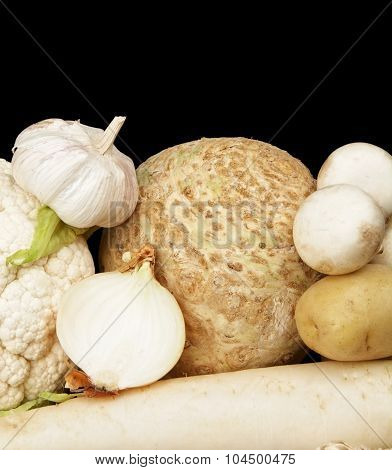 Collection Of White Vegetables On Black Bottom View