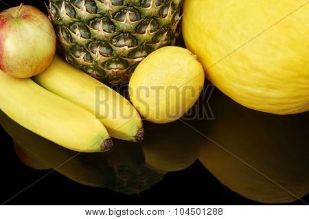 Set Of Yellow Fruits-pineapple,citrus,bananas On Black At The Bottom