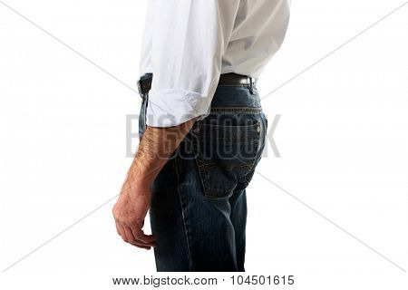 Fashionable mature men in jeans trousers.