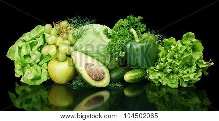 Collection Of Green Vegetables And Fruits On Black