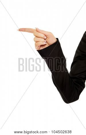 Businesswoman points something with finger