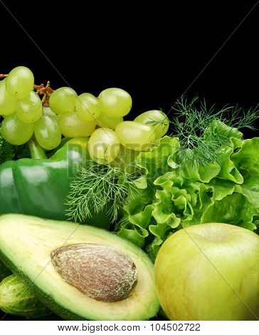 Group Of Green Vegetables And Fruits On Black