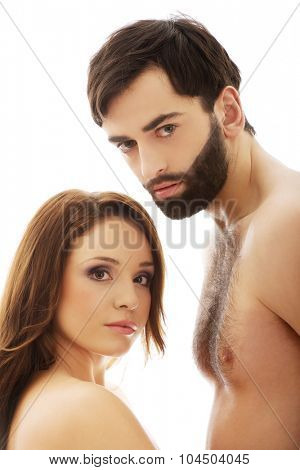 Young couple smiling to camera.