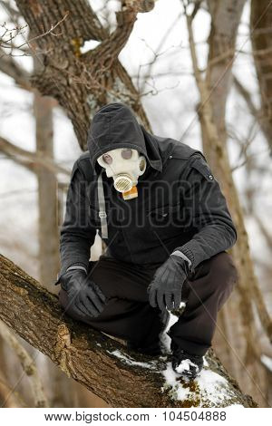 Man in Gas Mask lurking in the forest