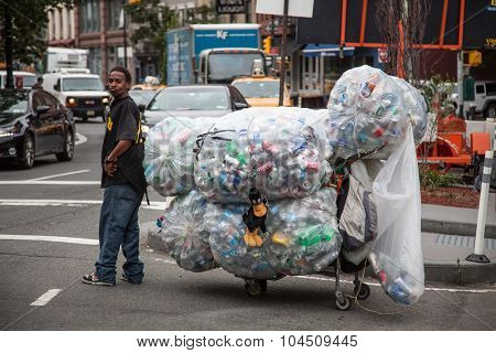 NEW YORK CITY, USA - SEPTEMBER, 2014: Guy collecting deposit bottles in New York City