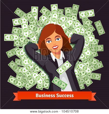 Business woman on pile of dollars. Success concept