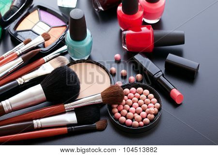 Cosmetics make-up on black background. Top view mock up.