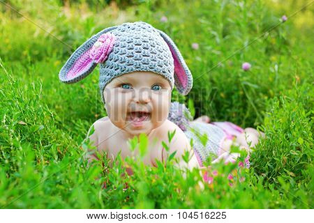 Funny Baby Enjoying The Green Grass.