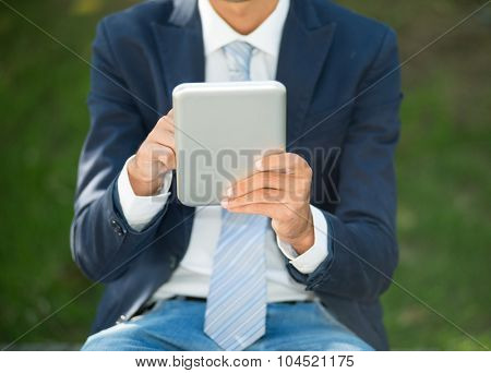 Detail of a man using a tablet computer