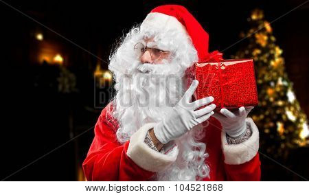 Santa Claus guessing what's in the box