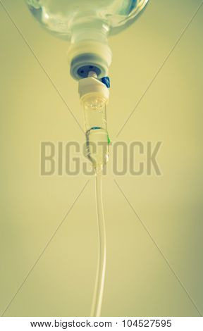 Infusion bottle with IV solution ( Filtered image processed vintage effect. )