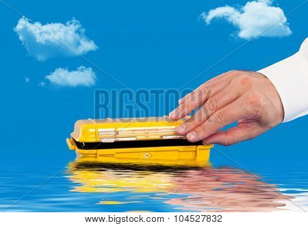 Opening a water resistant case floating in the water