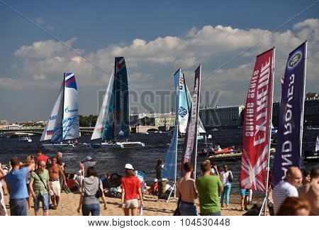 ST. PETERSBURG, RUSSIA - AUGUST 21, 2015: People on the beach watching races of Extreme 40 catamarans during St. Petersburg stage of Extreme Sailing Series. The Wave, Muscat team leading after 2 days