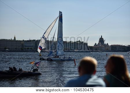 ST. PETERSBURG, RUSSIA - AUGUST 21, 2015: People watching races of Extreme 40 catamarans during St. Petersburg stage of Extreme Sailing Series. The Wave, Muscat team of Oman leading after 2 days