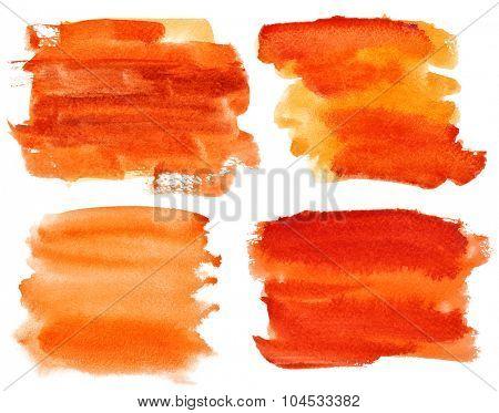Set of expressive orange watercolor brush strokes