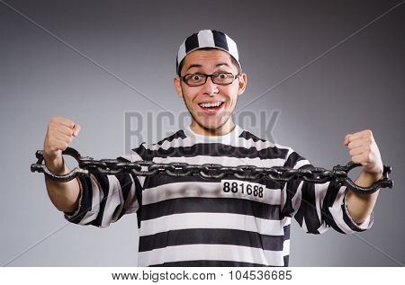 Young prisoner against gray
