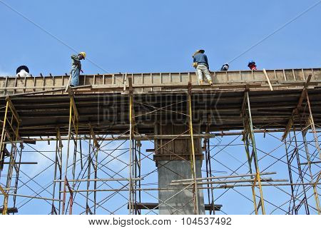 Group of construction worker fabricating beam formwork
