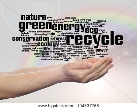 Concept or conceptual abstract green ecology, conservation word cloud text in man hand, rainbow sky background