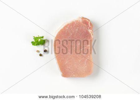 slice of raw pork tenderloin on white background