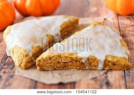 Two sweet autumn pumpkin scones with frosting