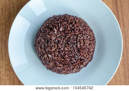 Rice Berry On White Dish Over Wooden Table